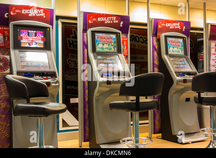 Fixed odds betting terminals (FOBT fixed odds betting terminal) in Ladbrokes Betting office. England. UK - Stock Photo