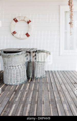 Wicker chairs on deck - Stock Photo