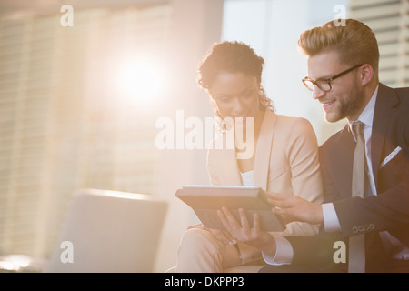 Business people using digital tablet in office - Stock Photo