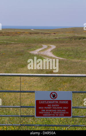 No Entry sign on gate at military firing range. Castlemartin Range. Pembrokeshire, Wales. June. - Stock Photo