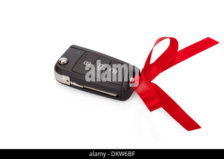 Gift idea: car keys with red ribbon isolated on white background - Stock Photo