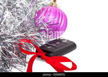 New year gift with car key and red bow isolated on white background - Stock Photo