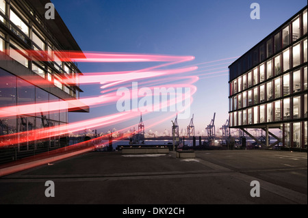 Neumühlen, modern office buildings, harbor cranes in the evening, Hamburg, Germany, Europe - Stock Photo