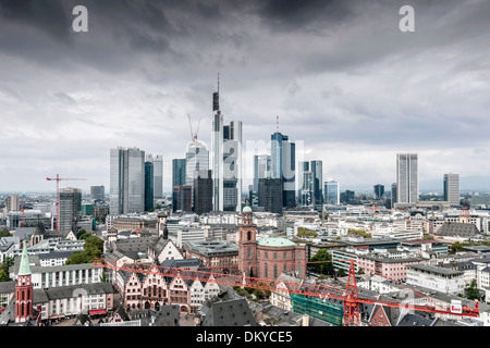 Skyline, black clouds over financial district, Frankfurt, Hesse, Germany - Stock Photo