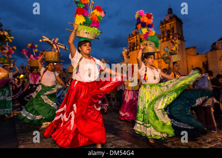 Young women dressed in traditional costumes parade in a comparsas during the Day of the Dead Festival in Oaxaca, - Stock Photo