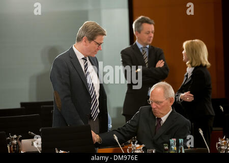 Berlin, Germany. 12th Dec, 2013. Chancellor Merkel and Interior Minister Friedrich meet with the Prime Ministers - Stock Photo