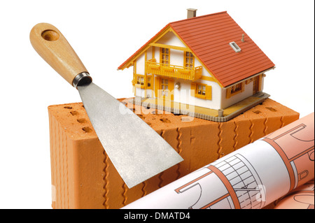 model house and tools on brick - Stock Photo