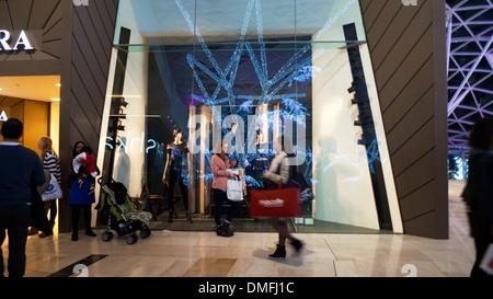 Shopper inside Westfield Shopping Mall in Shepherd's Bush West London England UK  KATHY DEWITT - Stock Photo