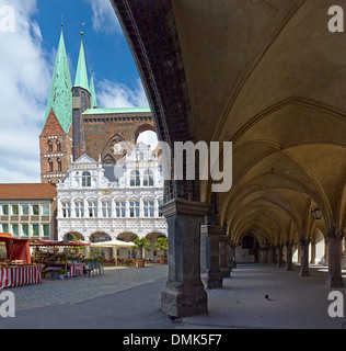 St. Marys Church, City Hall with arcades at market square, Hanseatic City of Lübeck, Schleswig-Holstein, Germany - Stock Photo