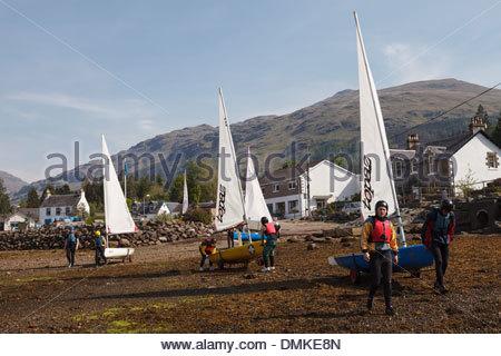 Group of children preparing to go sailing at Lochgoilhead - Stock Photo