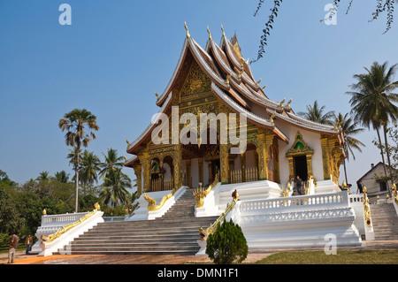 Horizontal view of The Palace chapel or Haw Pha Bang in Luang Prabang on a sunny day. - Stock Photo