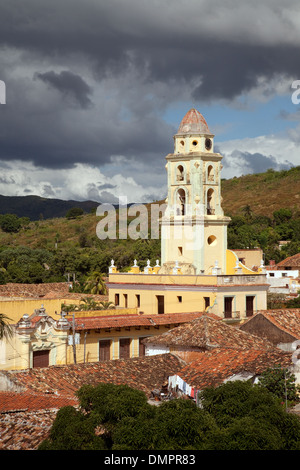 Grey clouds over the Church Convent of St Francis tower, Trinidad town, Cuba, Caribbean, Latin America - Stock Photo
