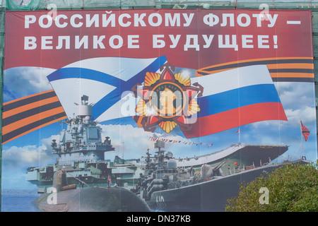 Russia, St Petersburg, Giant Propaganda poster outside the Nakhimov Naval School next to Cruiser Aurora - Stock Photo