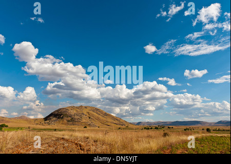 Vast arid landscape, blue sky with clouds, Isalo National Park near Ranohira, Madagascar - Stock Photo