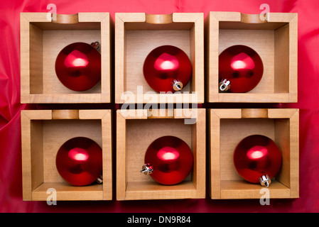 six red balls on wooden boxes - Stock Photo