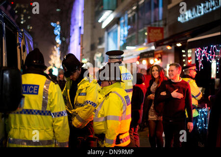 Manchester, UK. 20th December, 2013. Police and other emergency services are out in the streets on the night dubbed - Stock Photo