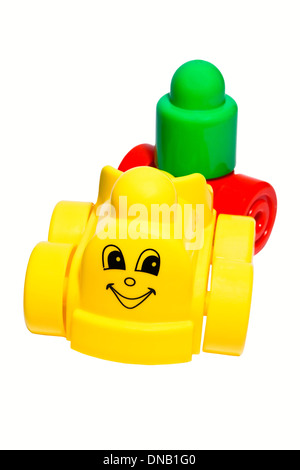 Children's toy - a plastic train on a white background. - Stock Photo