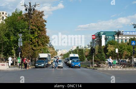 Bulevardul Unirii (Unification Boulevard) in Bucharest, the capital of Romania. - Stock Photo