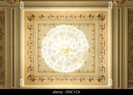 Ceiling and chandelier in one of the rooms of the Palace of the Parliament in Bucharest, the capital of Romania. - Stock Photo