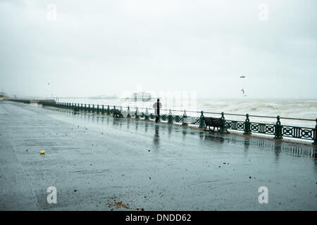 Jogger running in the storm, Hove Promenade, near Brighton, East Sussex, UK 23rd December 2013 - Stock Photo