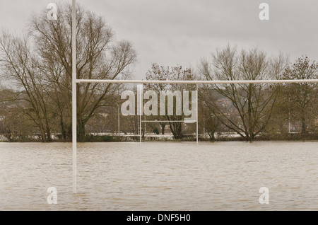 Flooded playing fields footpath in flood plane at Tonbridge School as river Medway floods floodplain - Stock Photo