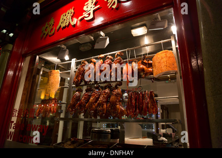 Roast ducks and other meats at a Chinese restaurant window in London Chinatown, England - Stock Photo