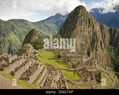 The ruins of the famous Inca city Machu Picchu in the sacred Urubamba valley near Cuzco in Peru with Huayna Picchu - Stock Photo