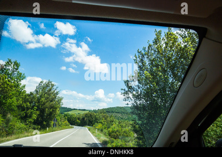 Road viewed from the window of a car, Volterra, Province of Pisa, Tuscany, Italy - Stock Photo