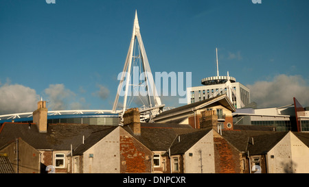 A view from the train of the Millennium Stadium and British Telecom BT building over house roofs Cardiff Wales UK - Stock Photo