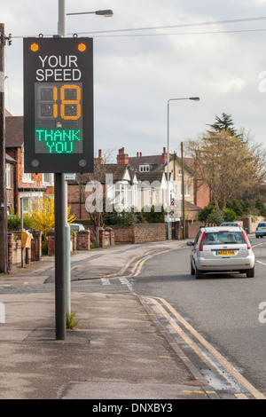 Traffic speed warning indicator by the road with a car well within the speed limit, England, UK - Stock Photo