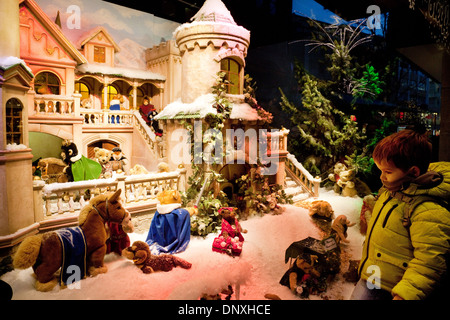 A child looking at toys in a shop store window at Christmas, Cologne, ( Koln ), Germany, Europe - Stock Photo