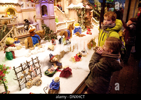 Children looking in a shop window at toys, at Christmas Xmas, Cologne, Germany, Europe - Stock Photo