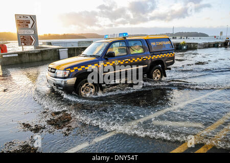 Portaferry, Northern Ireland. 6 Jan 2014 - A coastguard vehicle drives through seawater which has flooded the main - Stock Photo