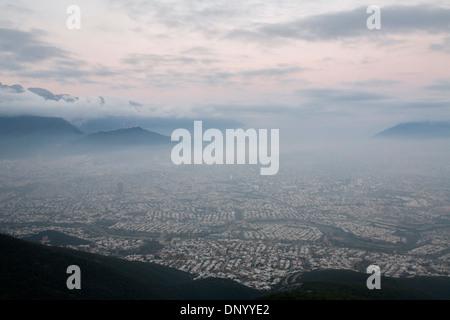 The city of Monterrey at daybreak from the Cerro de la Silla. - Stock Photo
