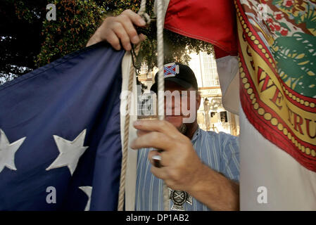 Apr 26, 2006; Lake Worth, FL, USA; Jimmy Shirley of Palm Springs attaches the First National Flag of the Confederacy - Stock Photo