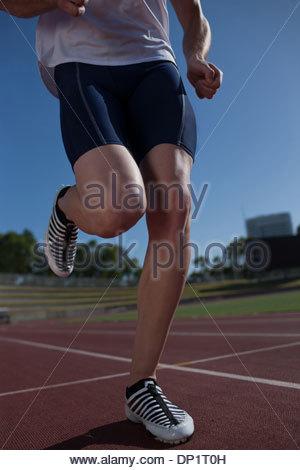 Runner running on track - Stock Photo