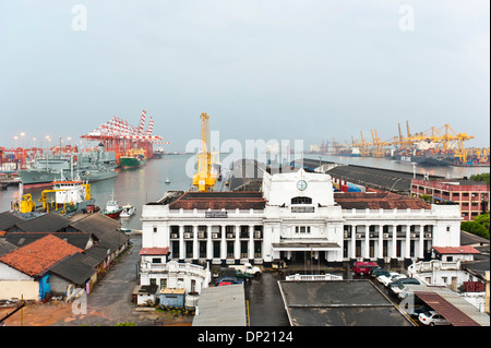 Colonial port building, the modern container port at the back, Colombo, Sri Lanka - Stock Photo