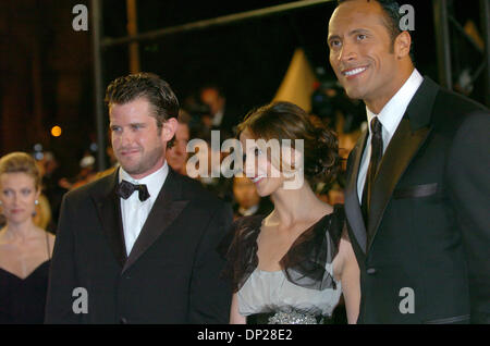 May 21, 2006; Cannes, FRANCE; Writer/director RICHARD KELLY with actors SARAH MICHELLE GELLAR and DWAYNE 'THE ROCK' - Stock Photo