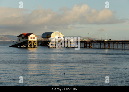 The old and new Royal National Lifeboat Institute boatsheds at the end of Mumbles Pier, Swansea Bay, December 2013 - Stock Photo