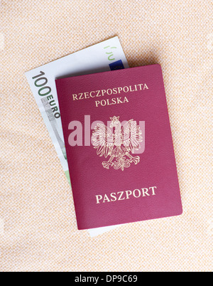Old Polish passport and one hundred Euro - Stock Photo