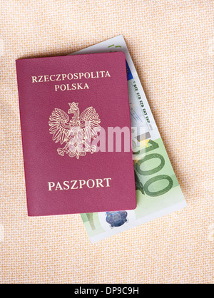 Euro banknote in red passport of Poland - Stock Photo