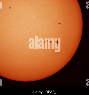 London, UK. 10th Jan, 2014.  Giant sunspot AR1944 is gradually crossing the solar disk. One of the largest sunspots - Stock Photo