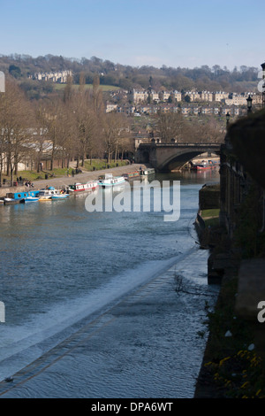 View of North Parade bridge across the River Avon in the Bath city, Somerset. England. Canal barge in foreground. - Stock Photo