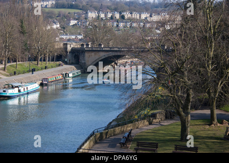 View of North Parade bridge across the River Avon in the Bath city, Somerset. England. Canal barges in foreground. - Stock Photo