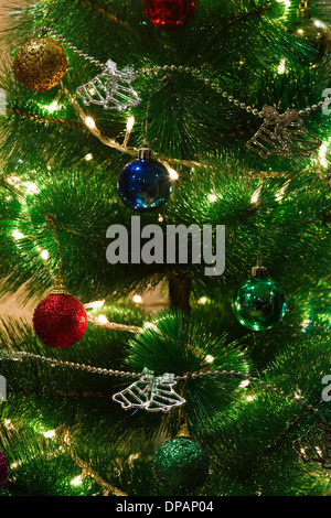 Decorated green christmas tree with lights - Stock Photo
