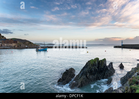 Boat and lighthouse in the harbour at Mevagissey a fishing port on the south coast of Cornwall - Stock Photo