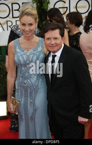 Los Angeles, USA. 12th January 2014. Michael J. Fox and wife Tracy Pollan attend the 71st Annual Golden Globe Awards - Stock Photo