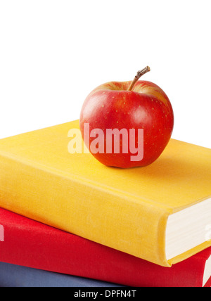 Red apple on a pile of books isolated on white background - Stock Photo