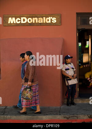 Dec 31, 2006 - Antigua, Sacatapez, Guatemala - Logos and traditional dress contrast in Antigua, Guatemala (Credit - Stock Photo