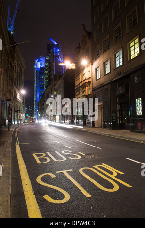 Bus stop and road leading to the famous Lloyds Building in the City of London, England. - Stock Photo